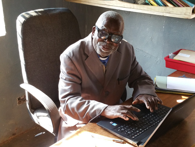 Rev. Chipeta with his new laptop